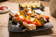 Tasty skewers with grilled with cheese and vegetables Stock Images