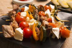 Tasty skewers with grilled with cheese and vegetables Stock Image