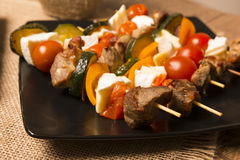Tasty skewers with grilled with cheese and vegetables Royalty Free Stock Images