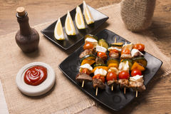 Tasty skewers with grilled with cheese and vegetables Stock Photo