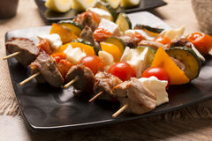 Tasty skewers with grilled with cheese and vegetables Royalty Free Stock Photography