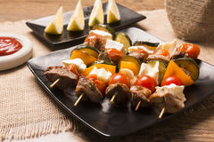 Tasty skewers with grilled with cheese and vegetables Royalty Free Stock Image