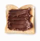 Tasty slice of bread with chocolate cream Stock Photos