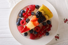 Tasty  Slice of fruit berry cake close-up on a plate. Horizontal Royalty Free Stock Photo