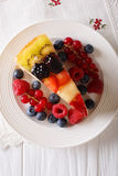 Tasty  Slice of fruit berry cake close-up on a plate. Vertical t Stock Image