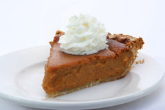 A tasty slice of pie with whipped cream Stock Photo