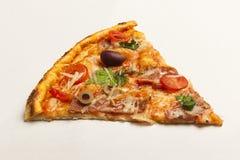 Tasty slice of pizza. Tasty slice of fresh pizza royalty free stock image