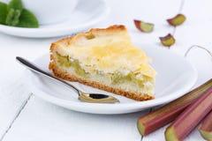 Tasty slice of rhubarb pie on white wooden table. Slice of rhubarb pie on wooden table stock photos