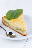 Tasty slice of rhubarb pie on white wooden table. Royalty Free Stock Image