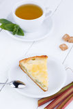 Tasty slice of rhubarb pie on white wooden table. Stock Image