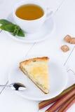 Tasty slice of rhubarb pie on white wooden table. Slice of rhubarb pie on wooden table stock image