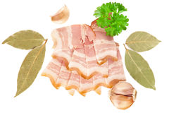 Tasty sliced bacon with laurel, parsley and garlic Stock Image