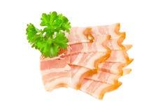 Tasty sliced bacon and parsley stock photos