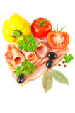 Tasty sliced bacon with vegetables and spices Royalty Free Stock Photos