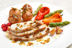 Tasty sliced roasted loin pork with potatoes Royalty Free Stock Images