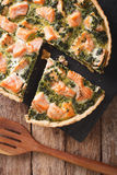 Tasty sliced Savory quiche with salmon and spinach, close-up. ve Royalty Free Stock Photos