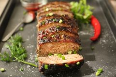 Tasty sliced turkey meatloaf. On baking tray royalty free stock photography