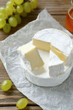 Tasty slices of camembert cheese Stock Photography
