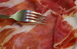 Tasty slices of Italian raw ham Royalty Free Stock Image