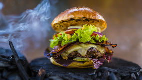 Tasty smoked and grilled beef burger. Stock Images
