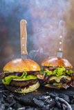 Tasty smoked and grilled beef burger. Royalty Free Stock Photography