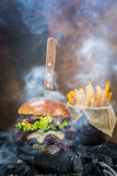 Tasty smoked and grilled beef burger. Stock Photos