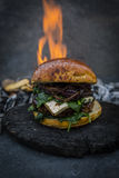 Tasty smoked grilled and glazed beef burger with lettuce, cheese Royalty Free Stock Photography
