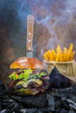 Tasty smoked grilled and glazed beef burger with lettuce, cheese Royalty Free Stock Image