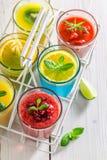 Tasty smoothie with fresh fruits. In white basket stock photos
