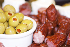 Tasty snack. Olives and small sausages snack stock photo