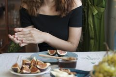 A tasty snack: plates of sulguni cheese and fig slices royalty free stock photography