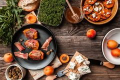 Free Tasty Snack With Cheese, Peach, Prosciutto Slices And Capers, Microgreen,on Wooden Table, View From Above, Place For Text Stock Image - 191278571