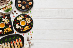 Tasty snacks on white wooden table, free space Stock Images