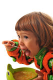 Tasty soup. The girl eats tasty soup during a dinner Stock Image