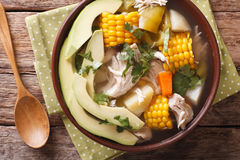 Tasty soup ajiaco with chicken and vegetables close up. Horizont Royalty Free Stock Image