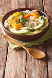 Tasty soup ajiaco with chicken and vegetables close up. Vertical Royalty Free Stock Photo