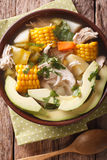 Tasty soup ajiaco with chicken and vegetables close up. Vertical Royalty Free Stock Images