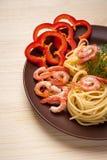Tasty spaghetti with prawns. On a wooden table, eat cooked spaghetti with prawns Royalty Free Stock Photos
