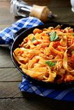 Tasty spaghetti with seafood in a frying pan Royalty Free Stock Photos
