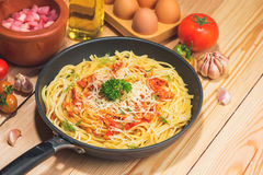 Tasty spaghetti with tomato sauce and meat in pan on wooden tabl Stock Images