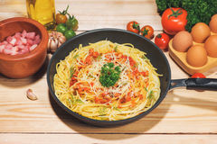 Tasty spaghetti with tomato sauce and meat in pan on wooden tabl Royalty Free Stock Images