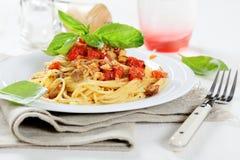 Tasty spaghetti with tomato sauce and mushrooms Stock Image