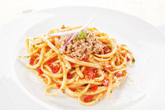 Tasty spaghetti with tomato sauce and tuna. Royalty Free Stock Images