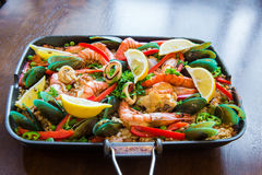 Tasty Spanish paella with seafood and chicken breast Royalty Free Stock Photo
