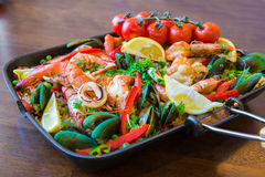 Tasty Spanish paella with seafood and chicken breast Royalty Free Stock Photography