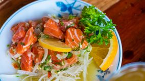 Tasty Spicy Fresh Salmon Salad. Served With Sliced Orange And Green Vegetable stock photo