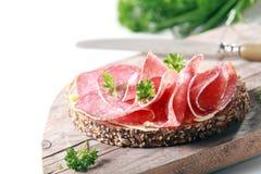 Tasty spicy Italian salami on wholegrain bread Stock Photography