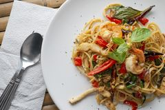 Tasty Spicy Seafood Spaghetti on a Bamboo Table.  royalty free stock photo