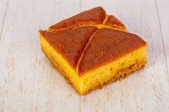 Tasty Sponge cake. Ower wooden background stock image