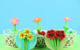 Tasty spring flowers muffin Stock Images